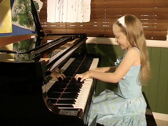 Phoebe playing piano at 9 years old